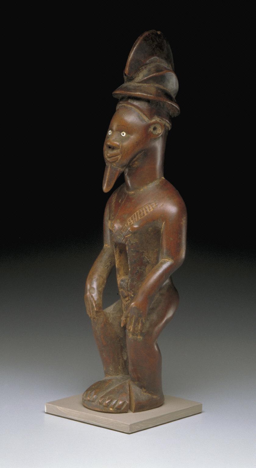 Squatting or Sitting Male Figure