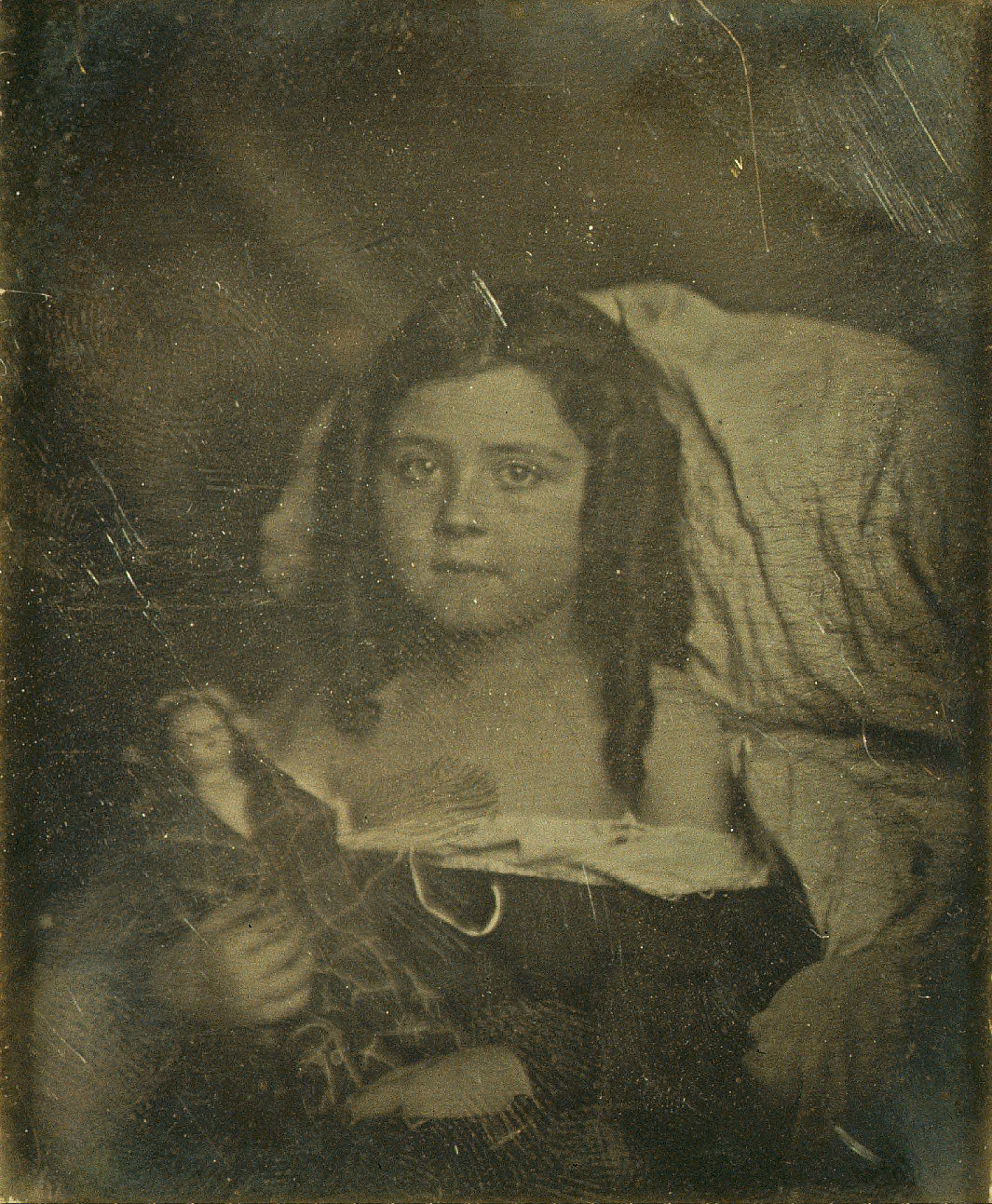 Portrait of girl with doll