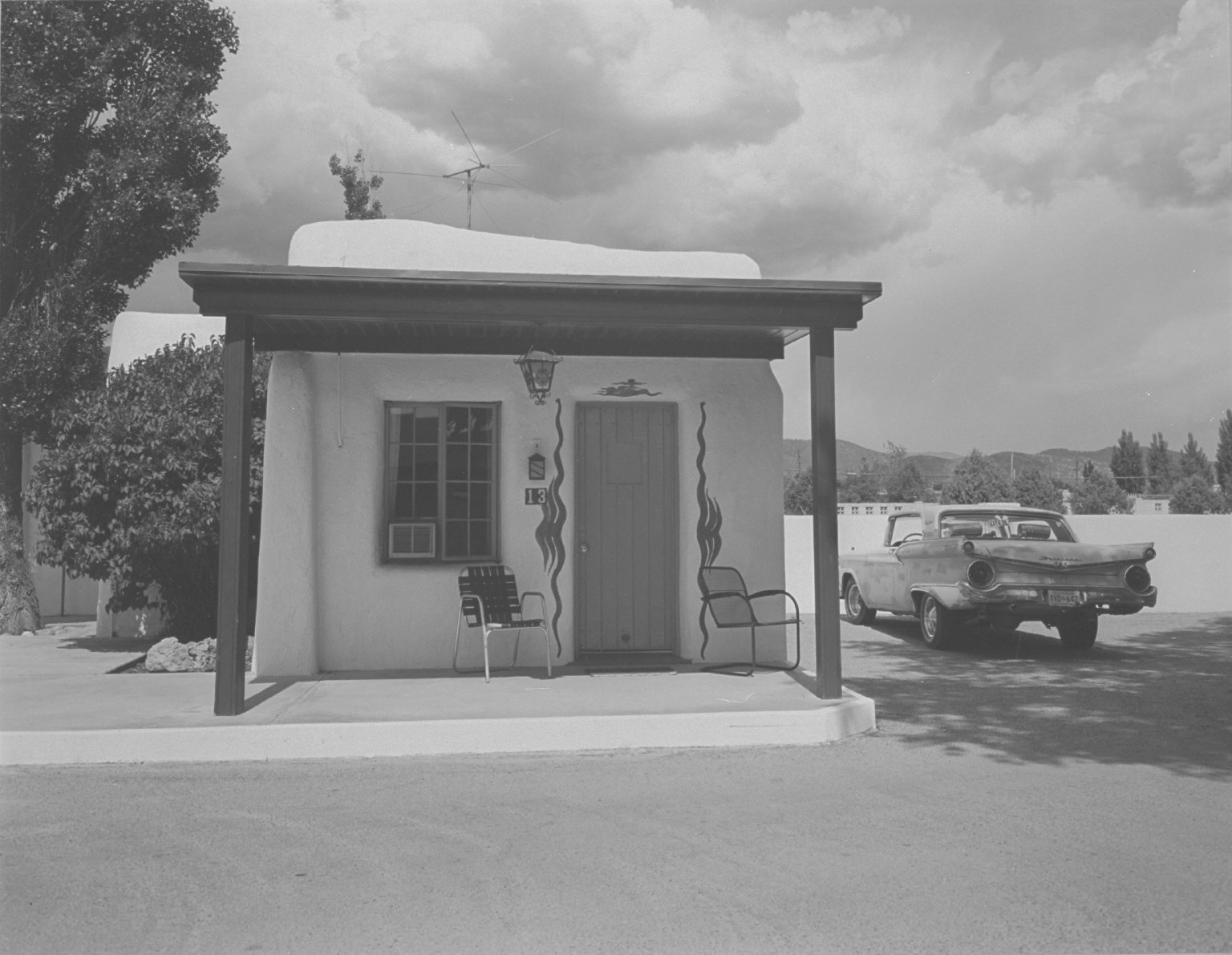 Motel room # 13 and automobile
