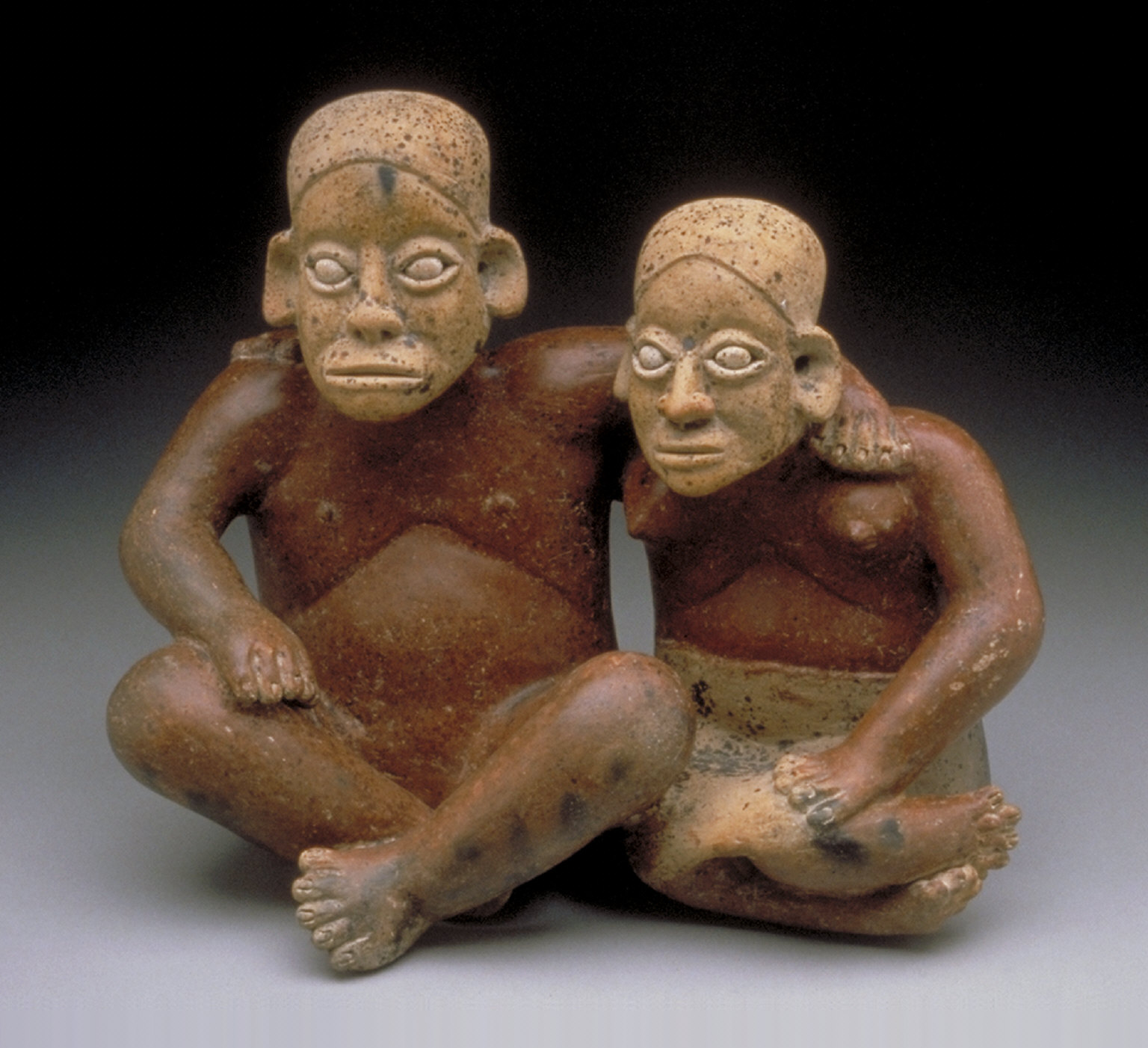 Seated man and woman