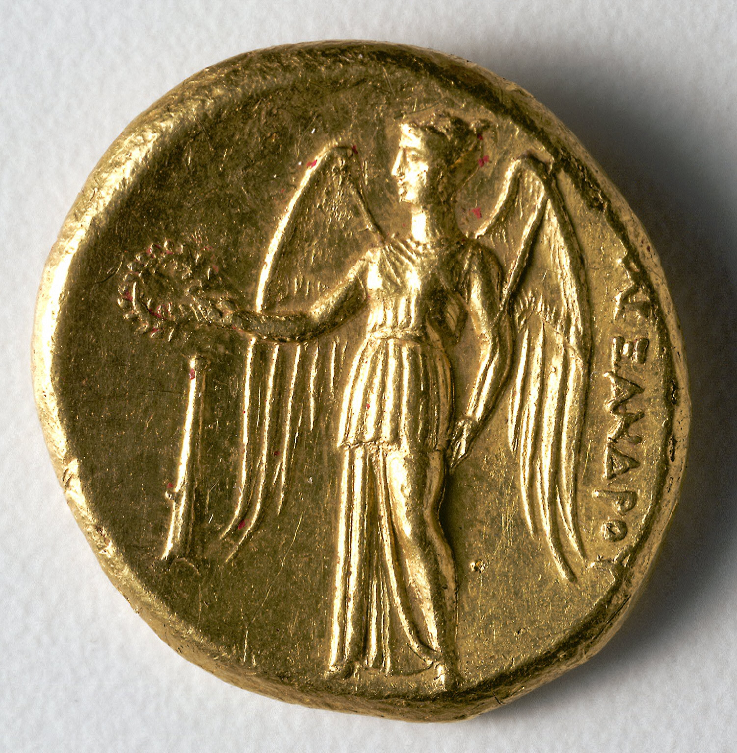 Stater: Winged Nike Holding a Wreath and Standard (reverse)