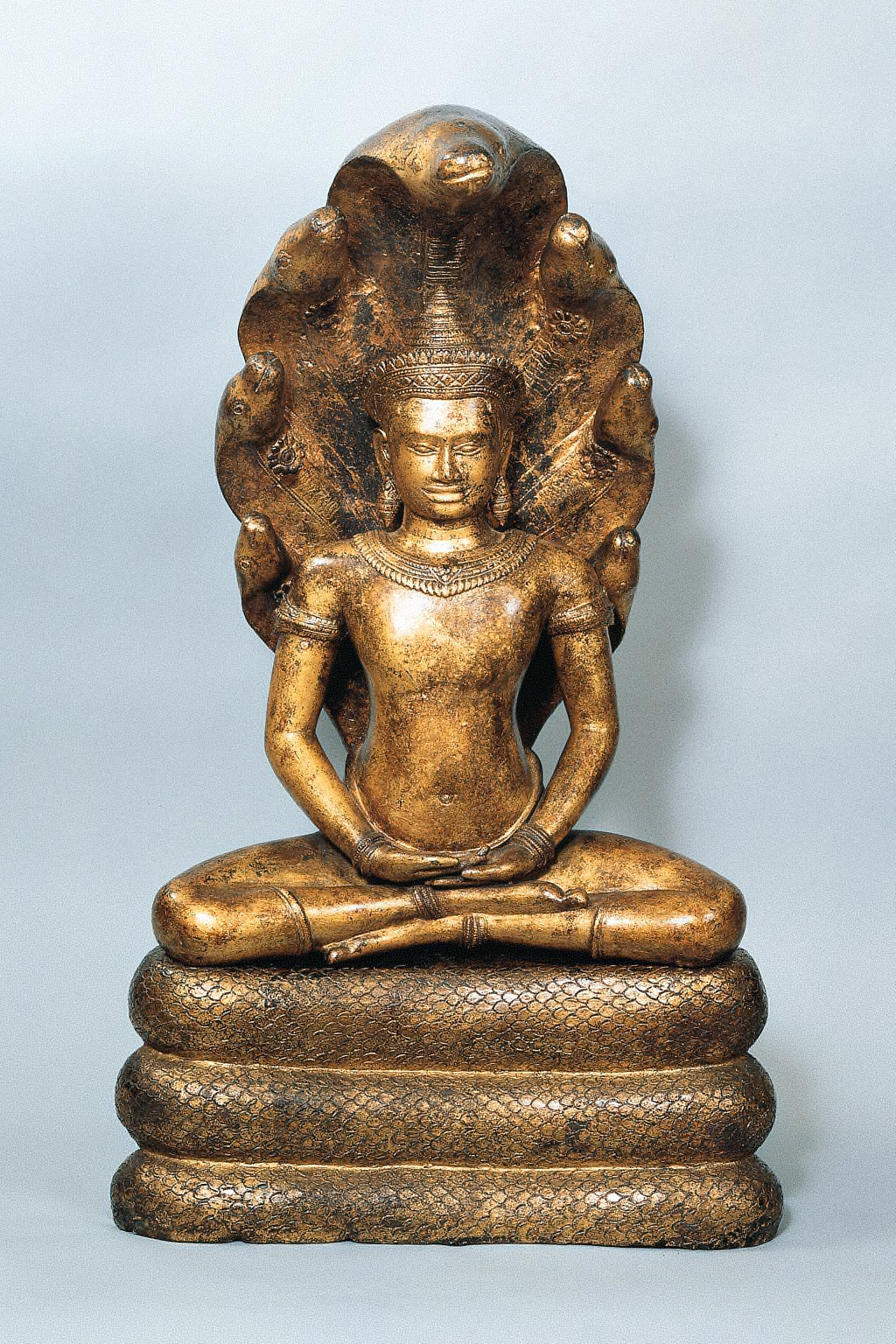 Crowned Buddha Seated in Meditation and Sheltered by Muchilinda