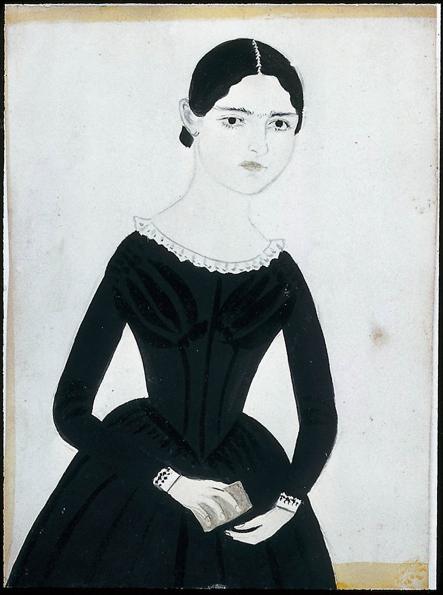 Girl in black Dress holding a gray Book