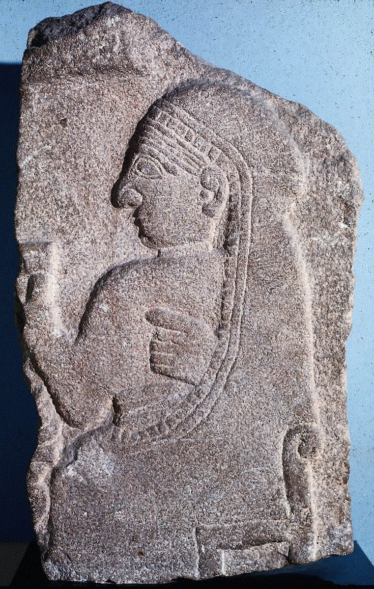 Relief with a seated woman or goddess