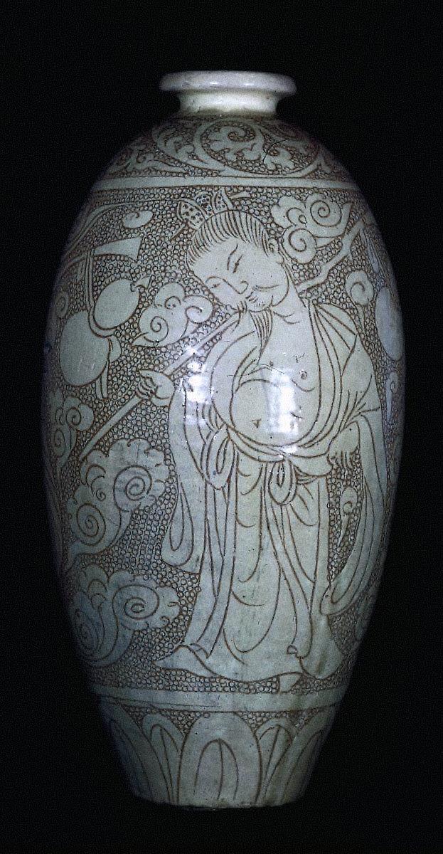 Wine jar incised with figures