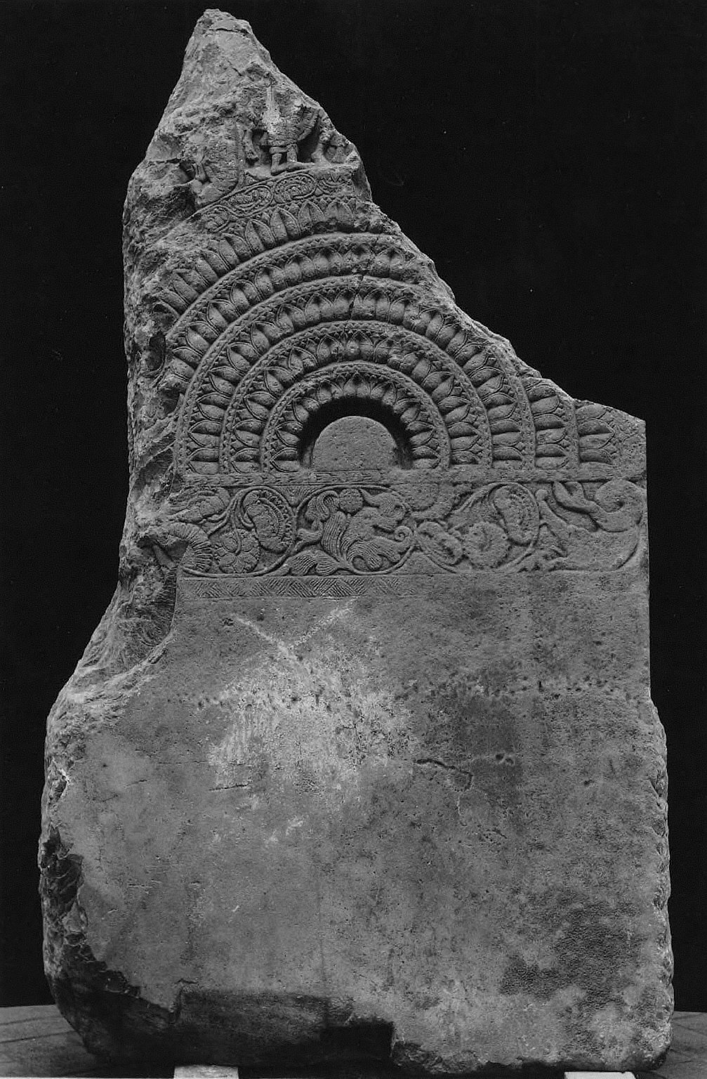 Architectural fragment: Half wheel with floral motifs
