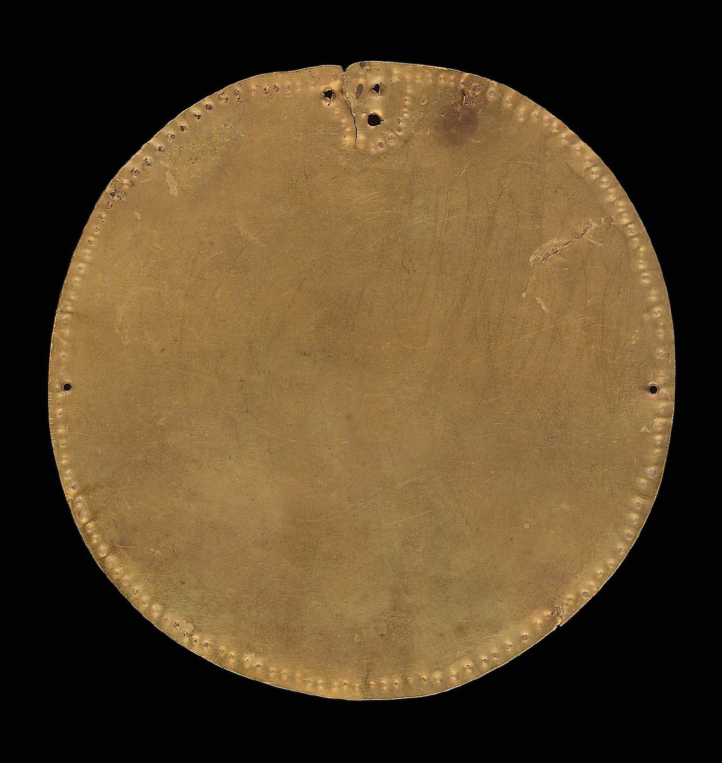 Embossed gold disk