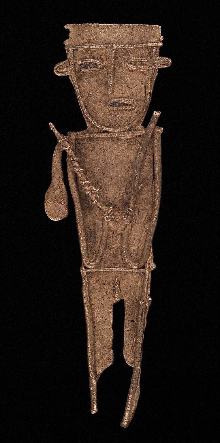 Male effigy figure holding weapons