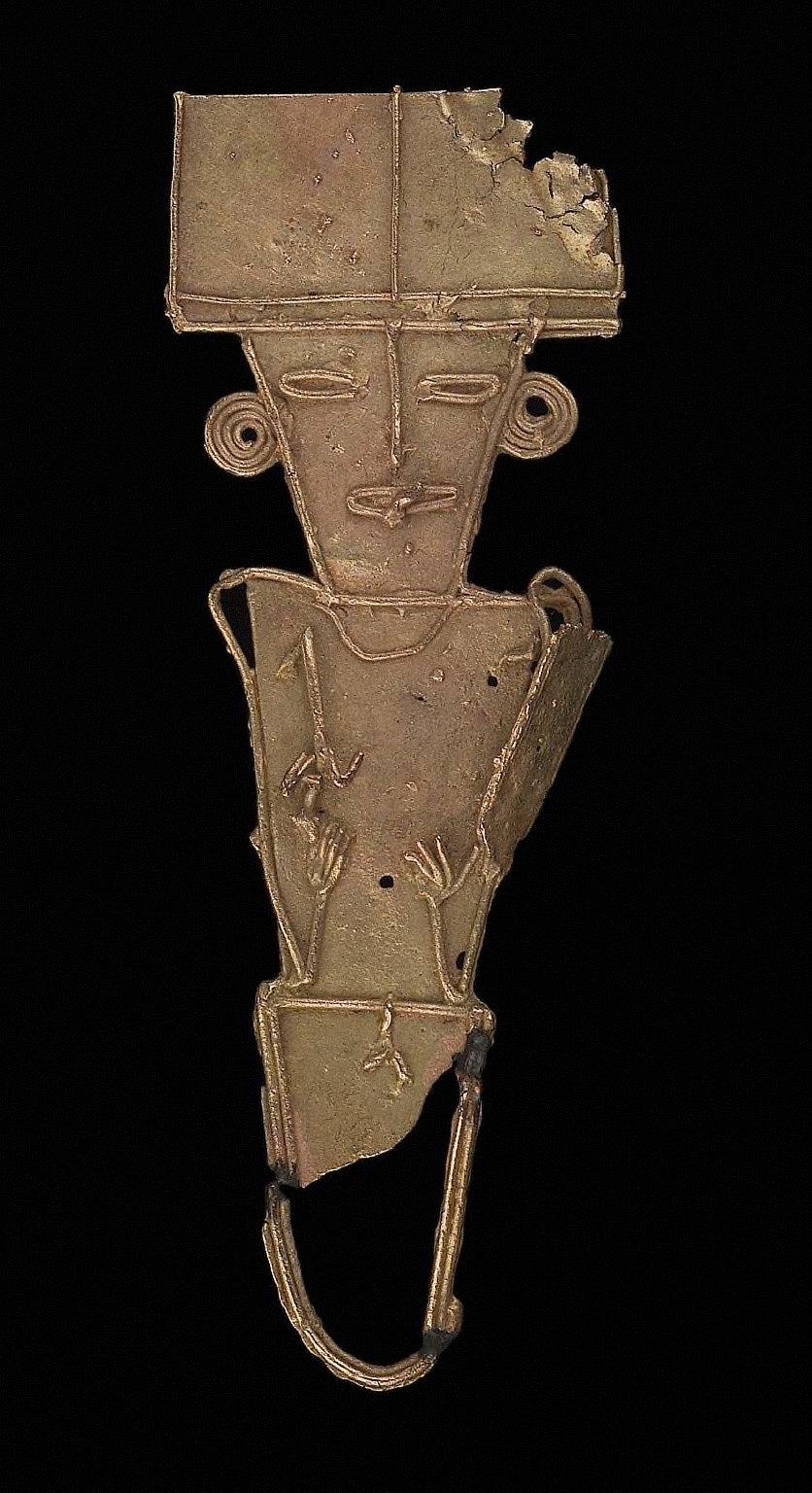 Male effigy figure holding spearthrower