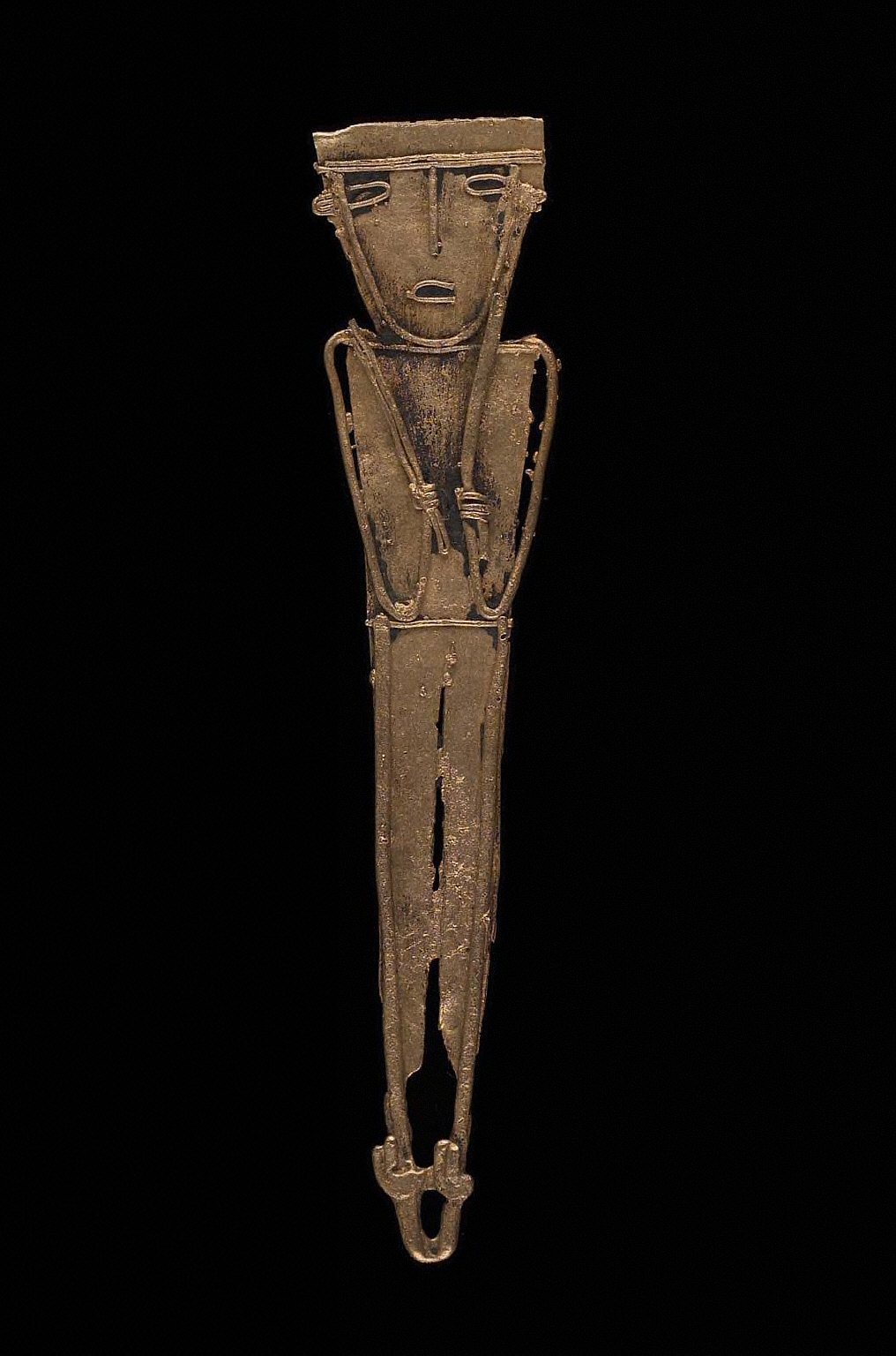 Male effigy figure holding spearthrower and darts