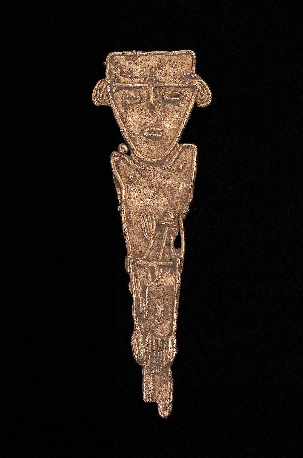 Male effigy figure holding a staff?