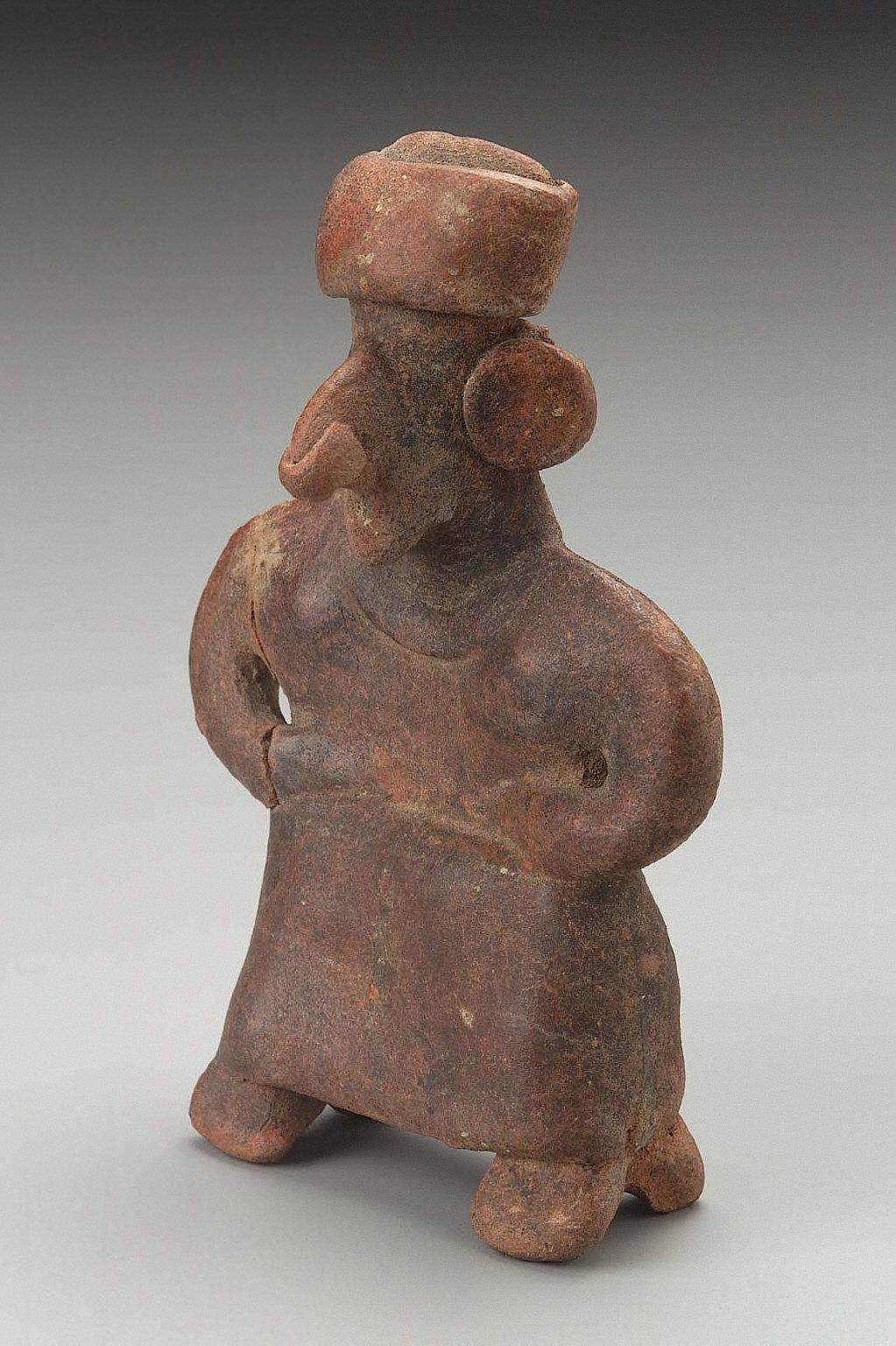 Standing female effigy