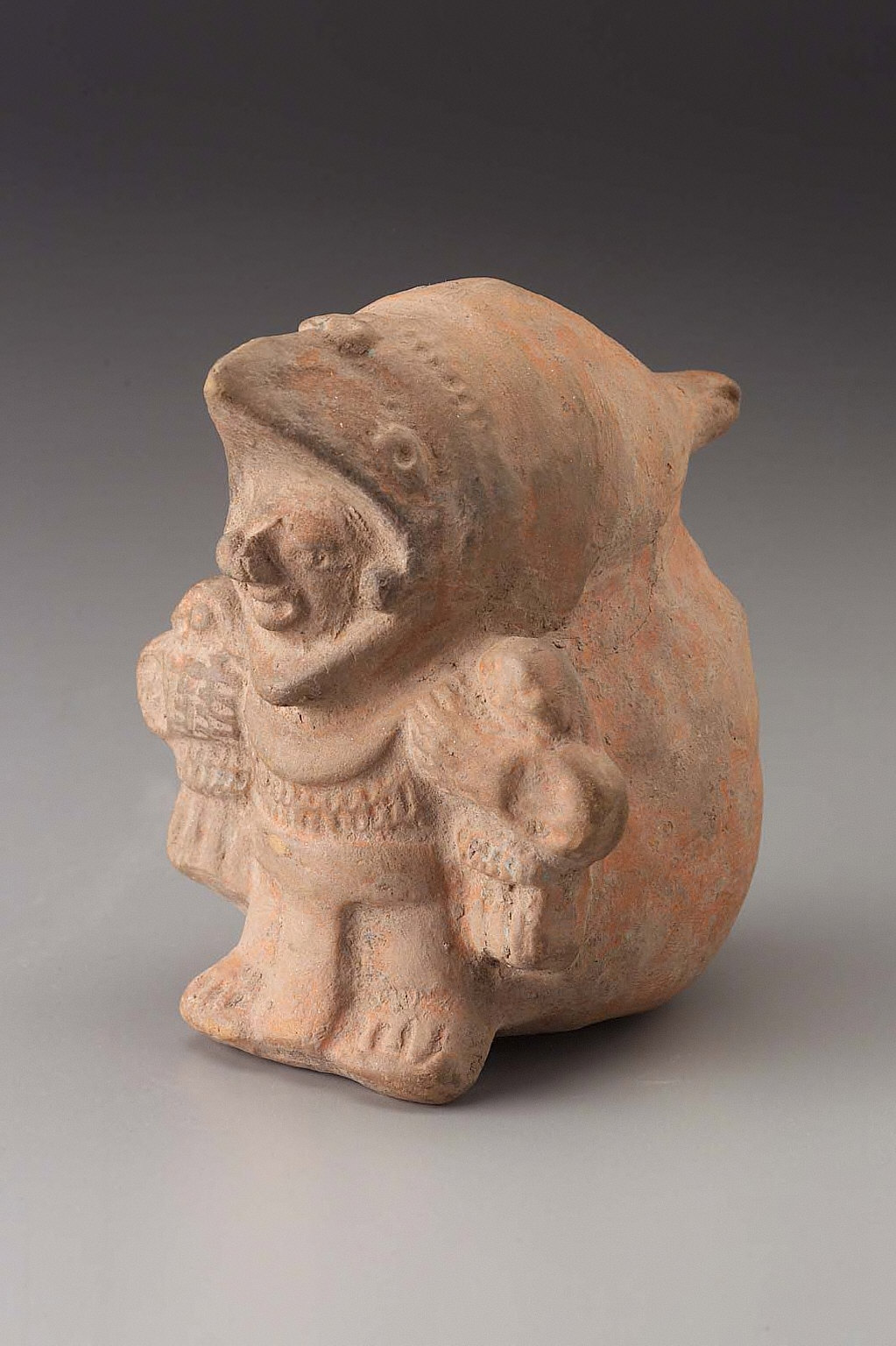 Costumed male effigy figure