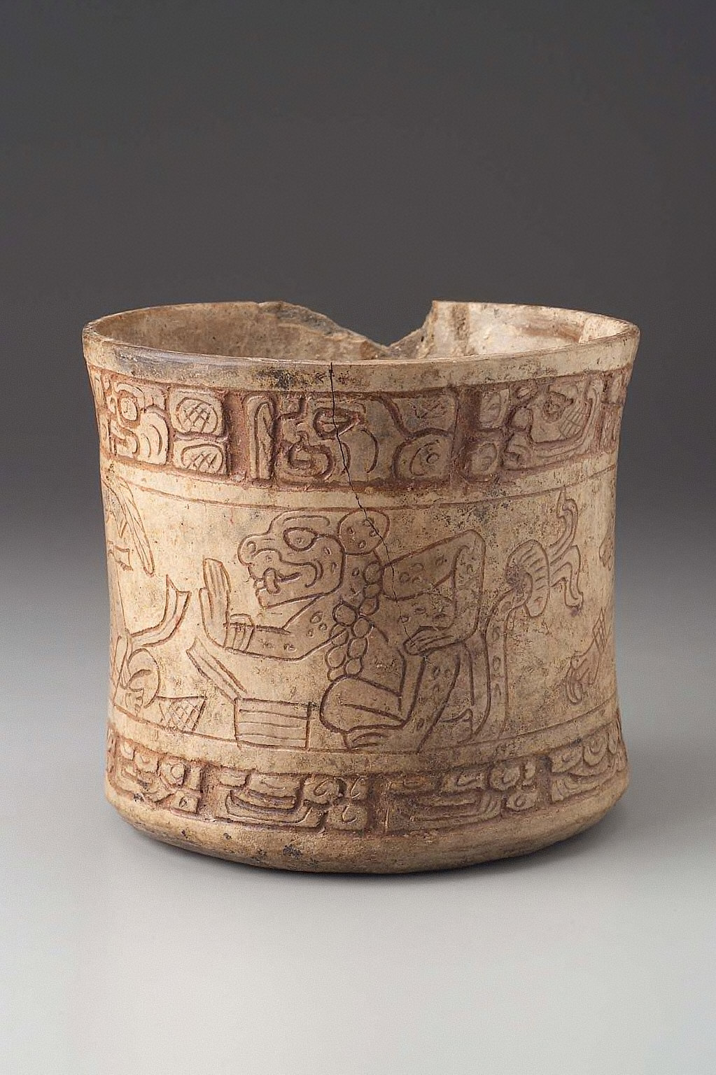 Incised vessel with animal figures