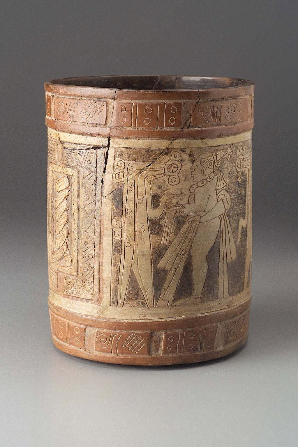 Cylinder vessel with incised decoration