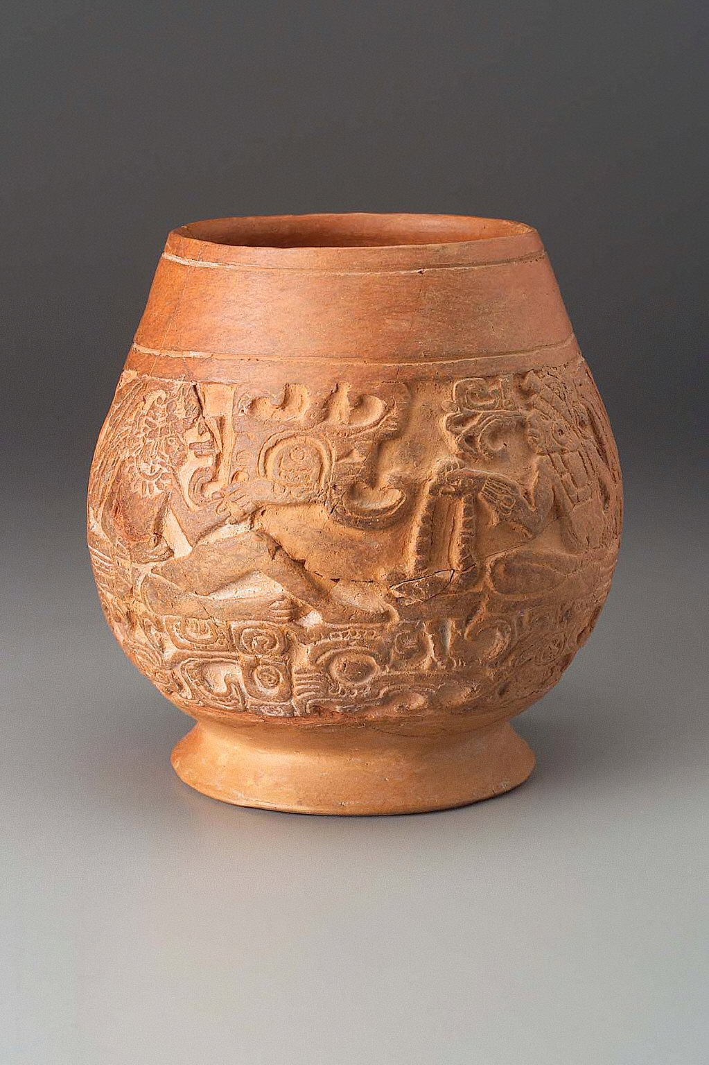 Vase with modeled and incised imagery