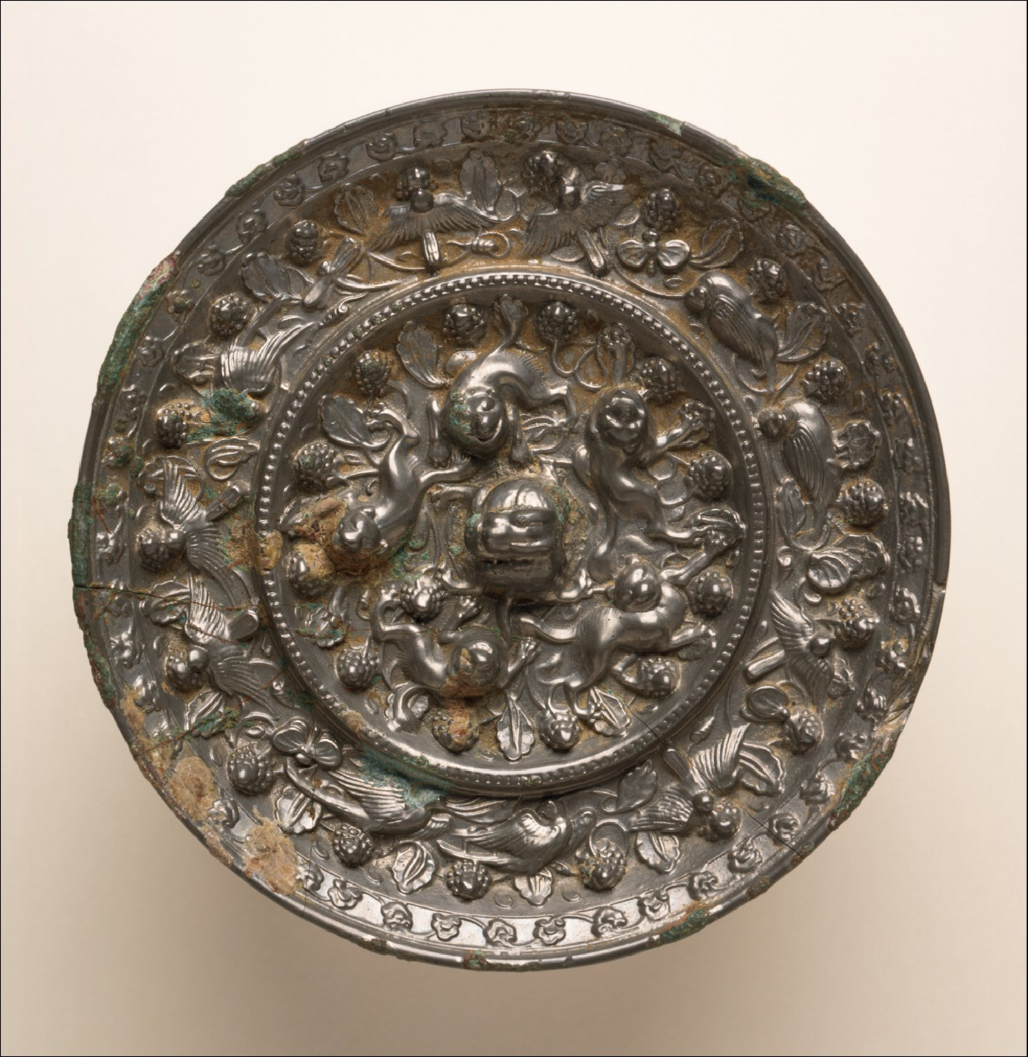 Mirror (Jing) with Grapevines, Birds, and Lions