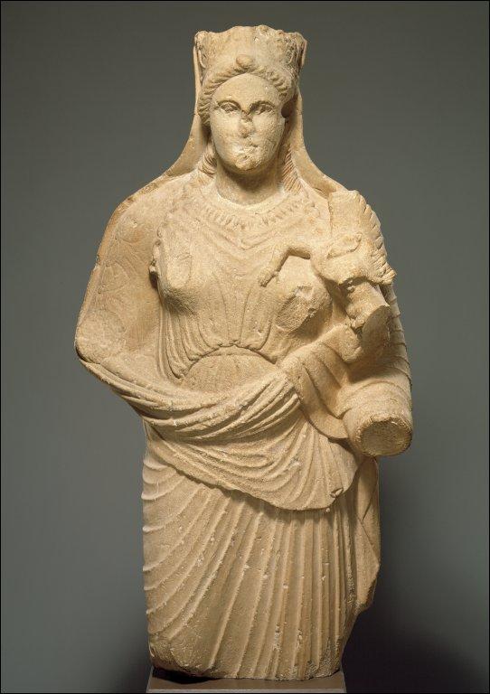 Statue of Aphrodite holding winged Eros