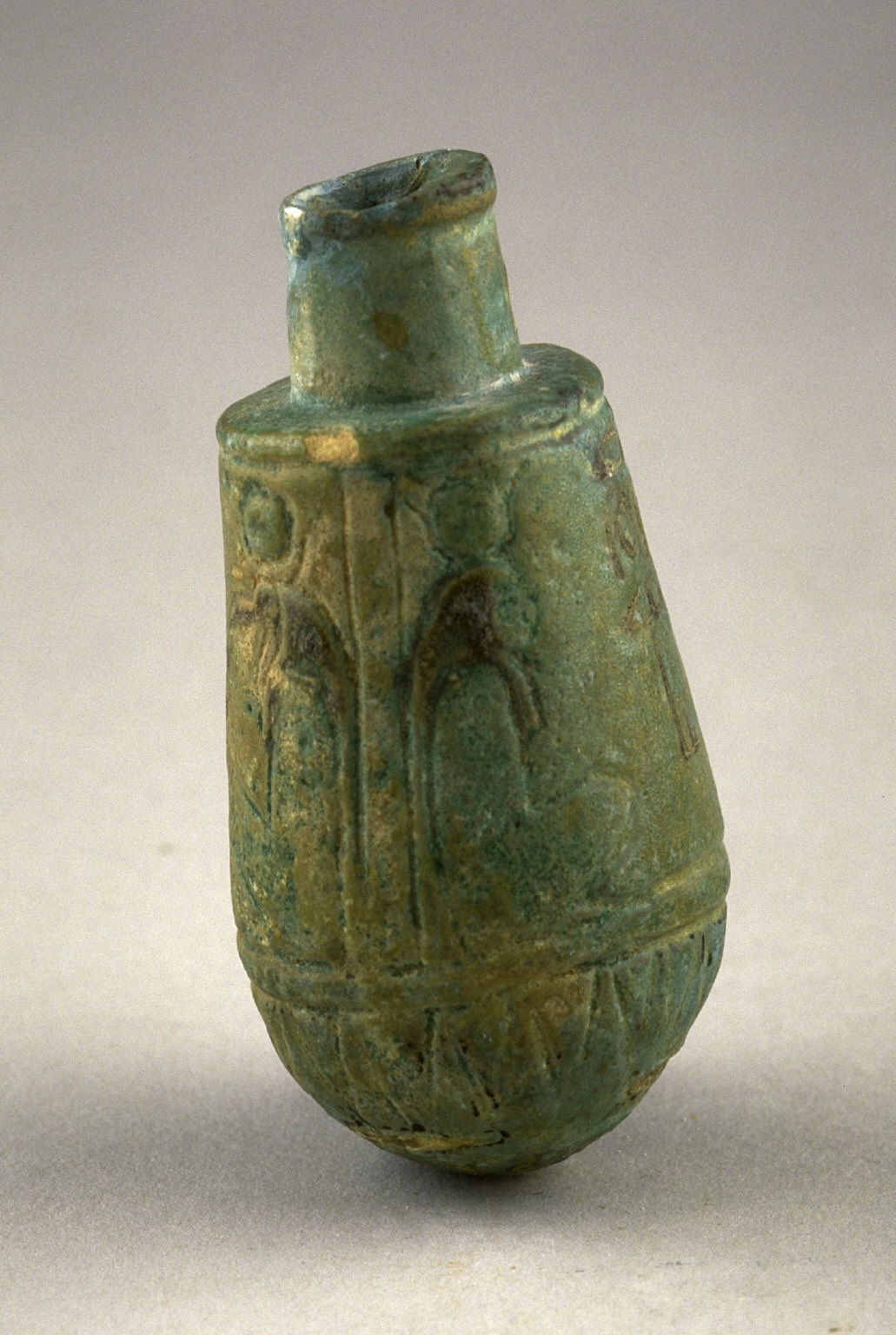Perfume bottle with incised figures