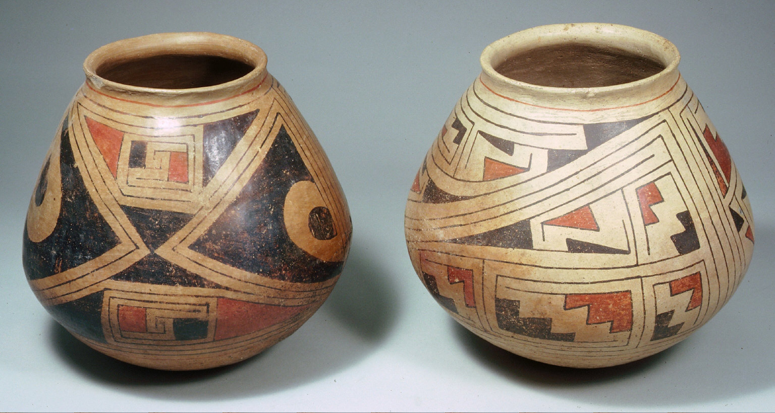 Bowl with kill hole red and white geometric designs on inside