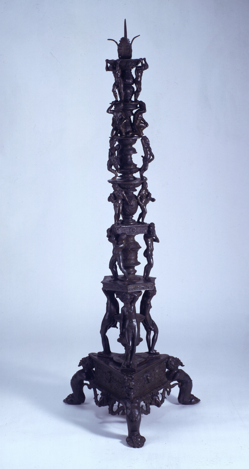 Altar candlestick black, with eighteen figures on six levels
