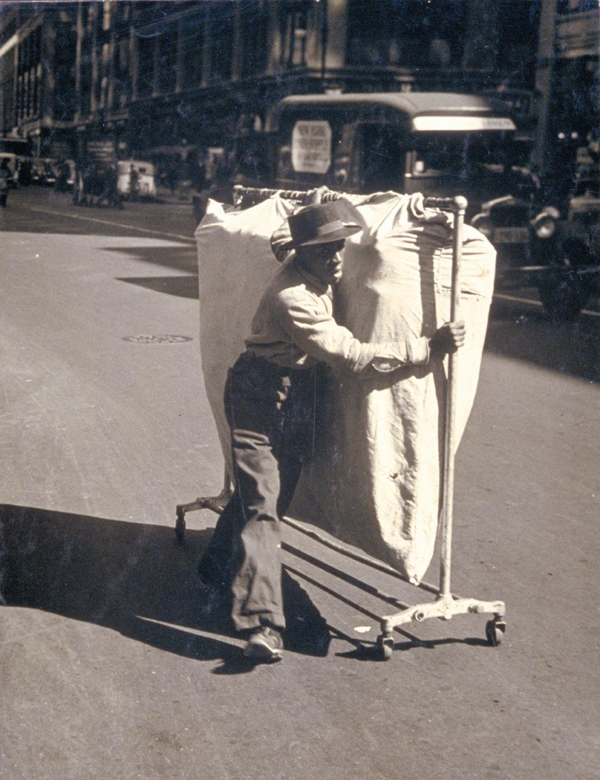 Man pushing garmet rack