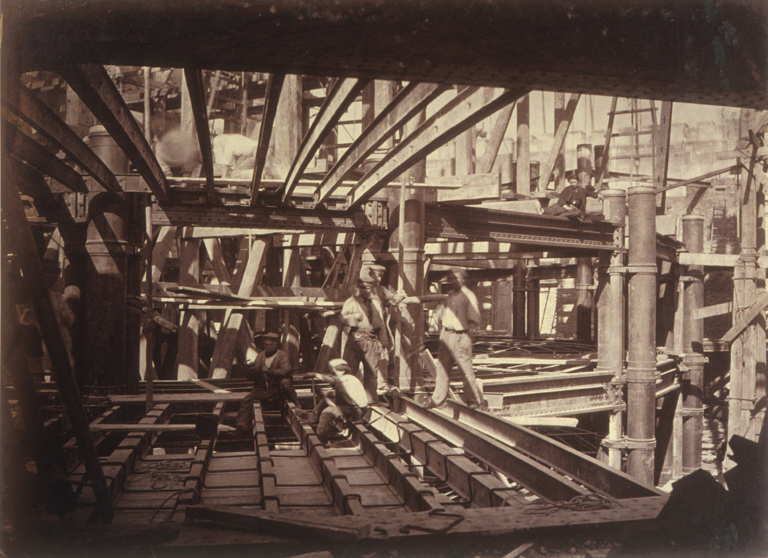 Interior View of the Construction of Ch. Garnier's Opera House, Paris. Men at work on girders.