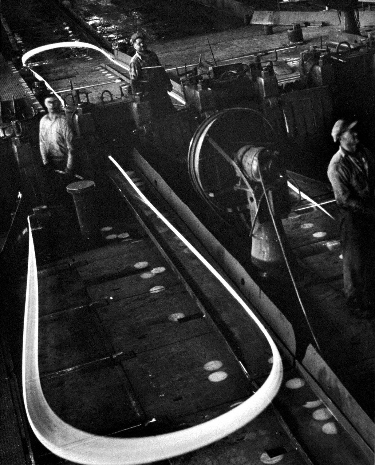 Men working in steel factory