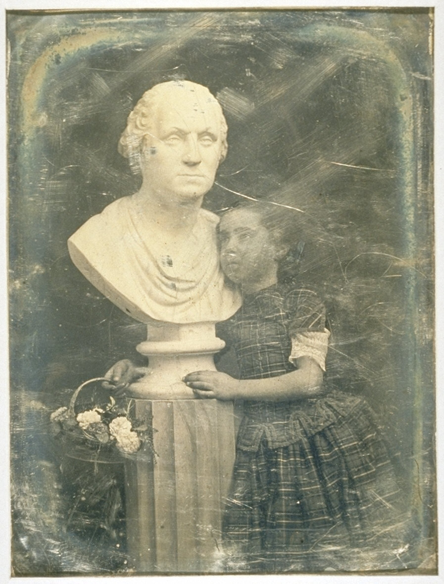 Helia Harrison with a bust of George Washington