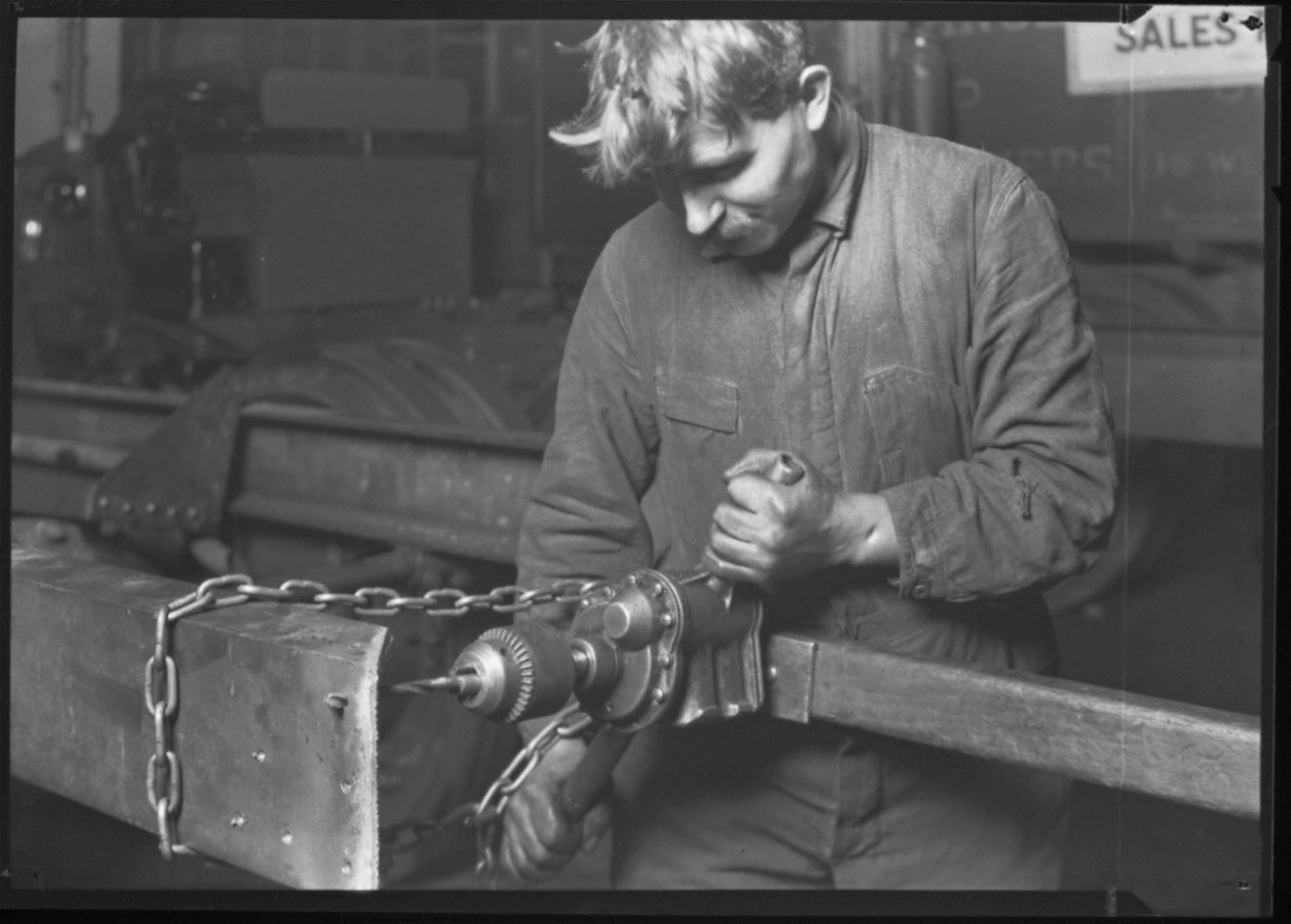 Repairman In Packard Service Station Working On Truck Chasis