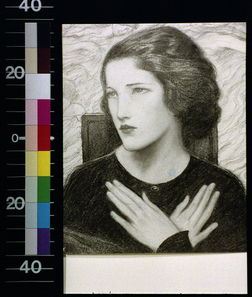 Head and shoulders of girl with hands crossed