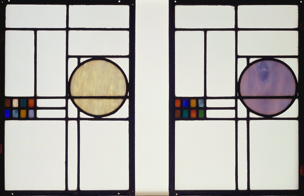 Pair of windows from the Capital Building and Loan Association