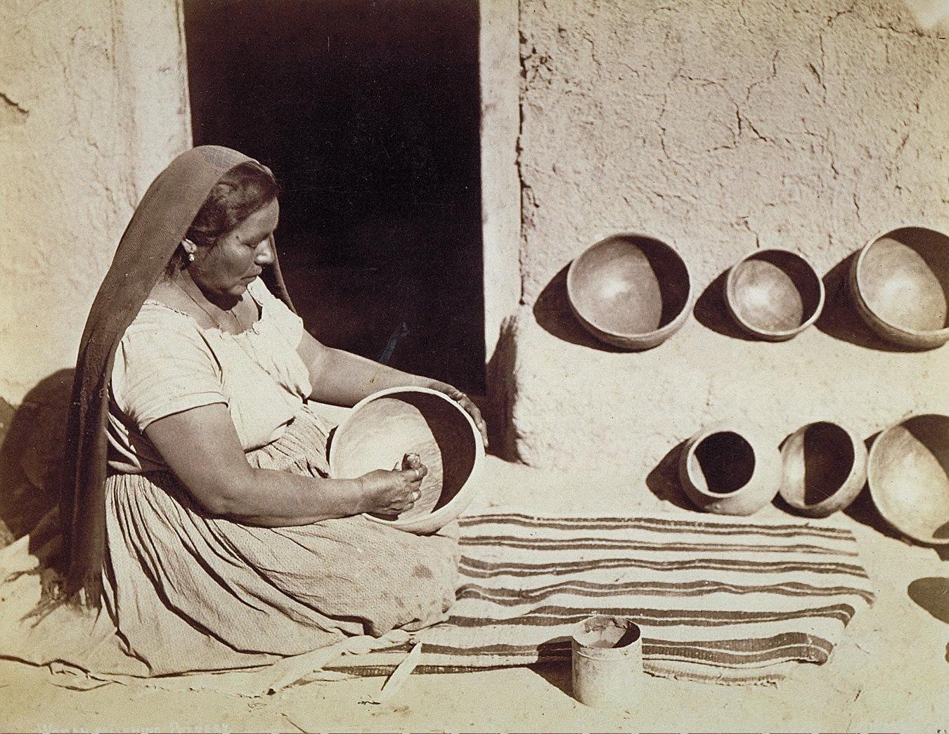 Woman Polishing Pottery