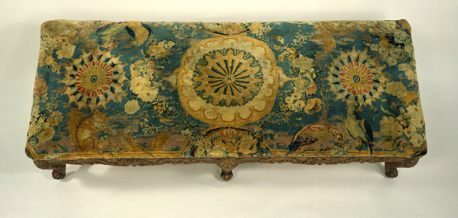 Knotted Pile Bench Cover showing Medallions, Squirrels, and Parrots on a Blue Ground